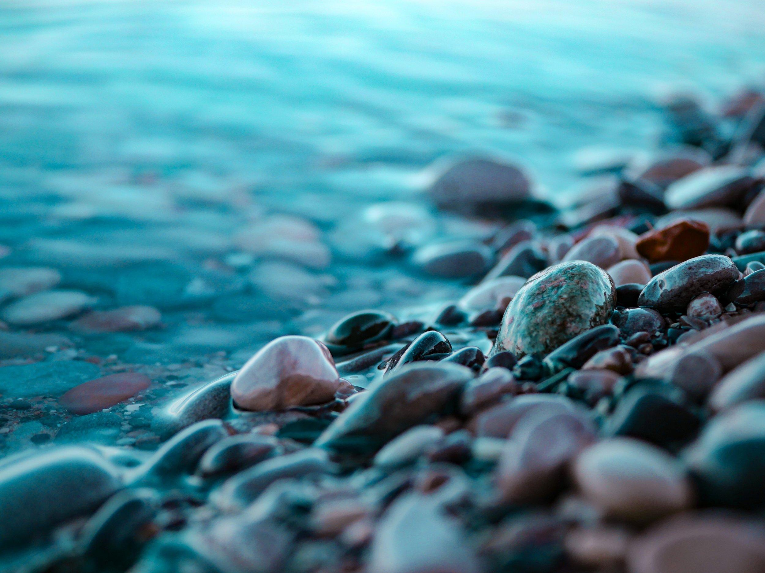smooth pebbles and calm sea