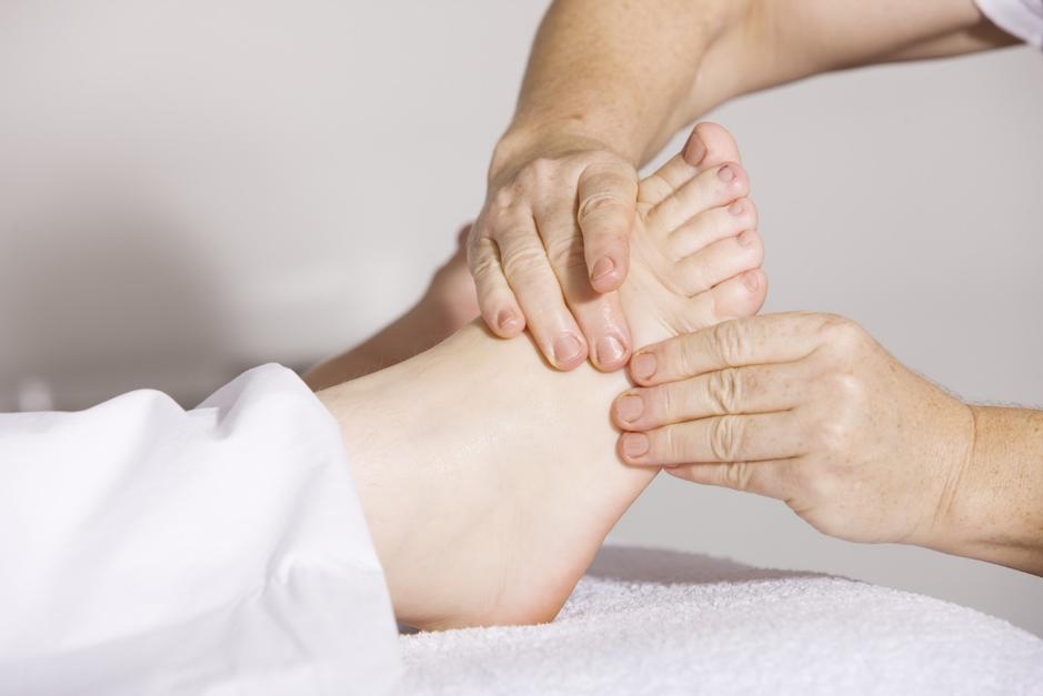hands massaging a foot